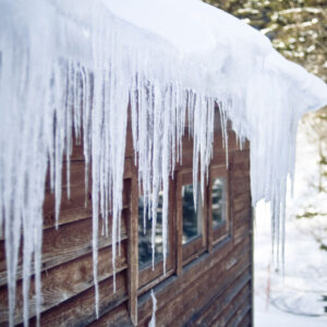Large icicles on the edge of a roof.