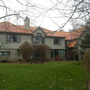 Large house with a cedar shake roof.