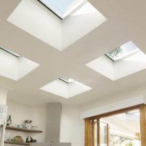 Four square skylights in a white room.