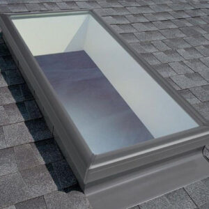Large rectangular skylight on a shingled roof.