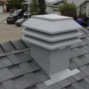 White cupola vent on a roof.