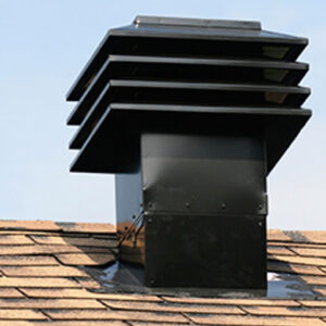 Black cupola vent on a roof.