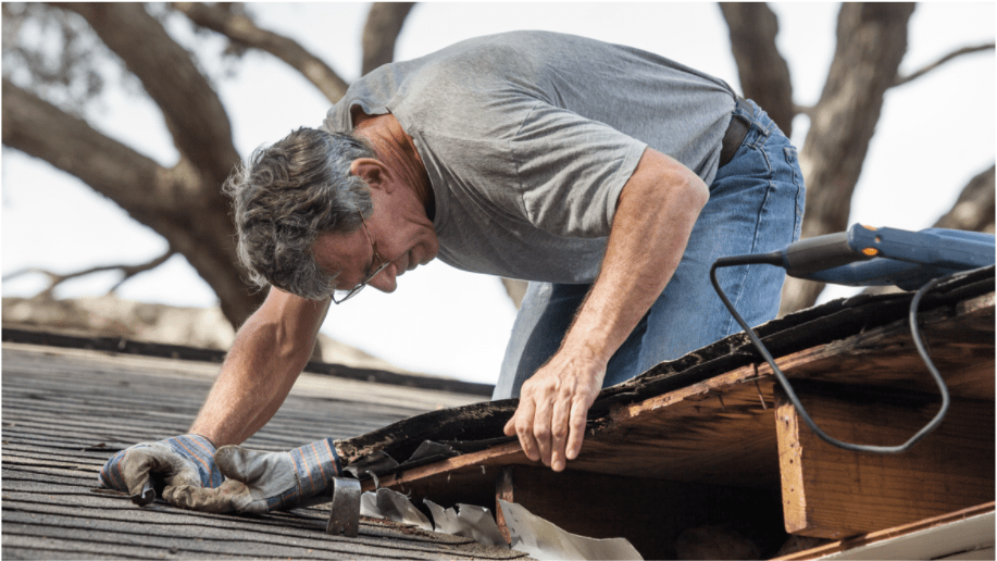 man inspecting a roof for leaks and damage