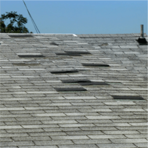 black roofing tiles covering up the damaged areas on a grey roof