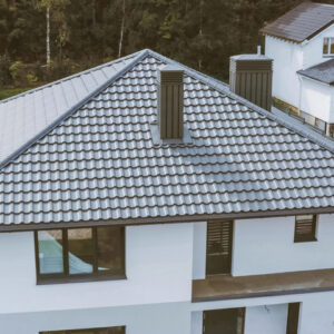beautiful grey roof on a white home